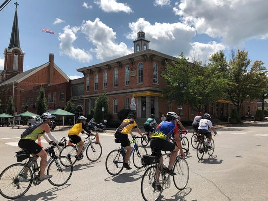 RAGBRAI riders make their way into downtown Iowa City,