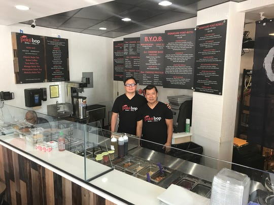 Sung S. Song, left, and chef Tommy Hwang are co-owners