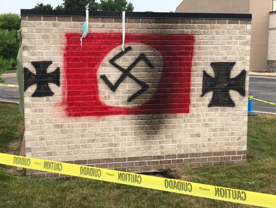 Vandals painted a Nazi flag on a garbage bin shed at