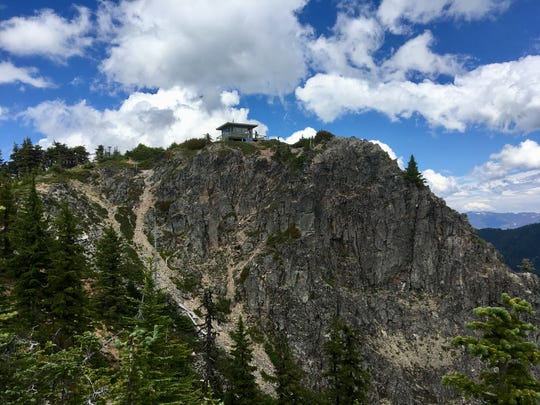 Coffin Mountain Lookout sits atop dramatic cliffs in