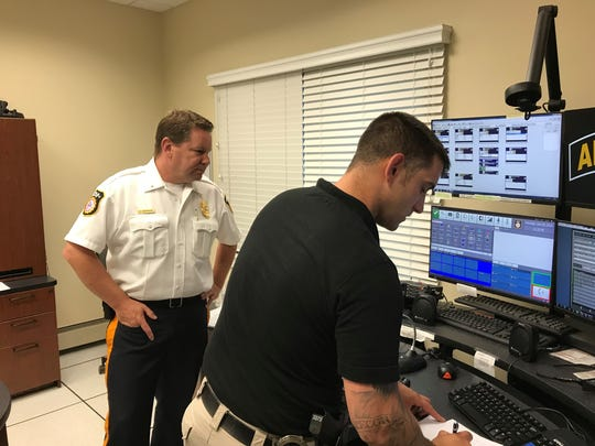 Incoming Verona Police Chief Christopher Kiernan, left, checks in with officer Justin Nielsen on July 30, 2018, in the dispatch center Kiernan helped implement.