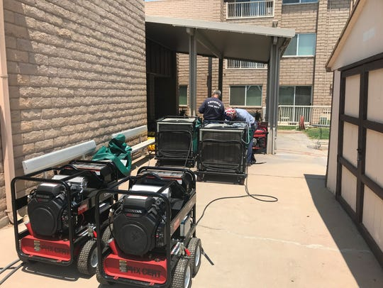 Phoenix Fire Department crews assist residents of a senior housing facility that lost power during a monsoon storm July 30, 2018, and was still without electricity 18 hours later.