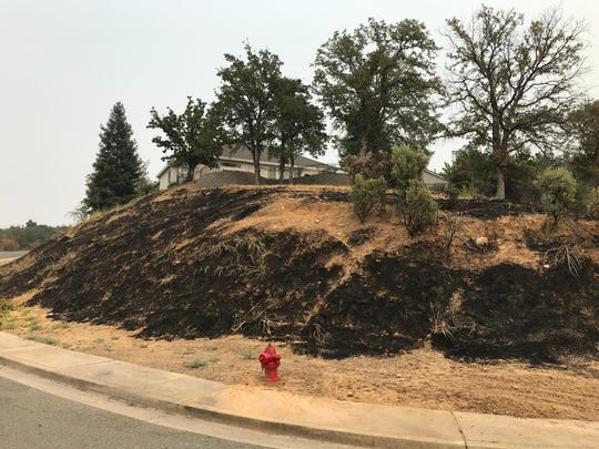 A home burned down and another was damaged at the end of Stanford Drive, also in west Redding. Nearby, flames burned a grassy landscape on a hill leading up to another home, which was spared.  The Carr Fire left wide swaths of scorched grasslands leading up to homes in urban areas that had defensible spaces.