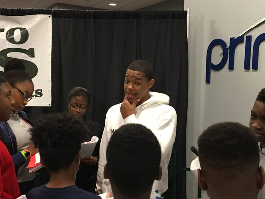 Seton Hall's Shavar Reynolds speaks with middle-school participants in Write on Sports at the Prudential Center.