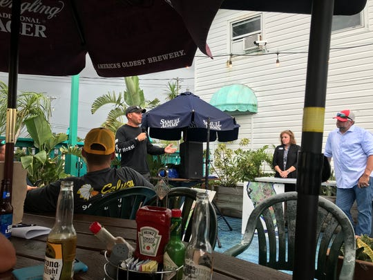 Billy Norris speaks at The Fish House Restaurant in Bonita Springs Tuesday, July 31, 2018. Norris and other Southwest Florida fishing captains gathered to share their concerns about how red tide has impacted their businesses.