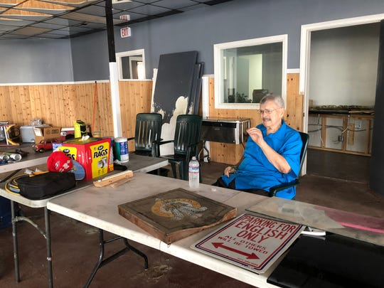 Larry Bitonti, owner of Hair of the Dog English Pub, sits in the area that will be the bar at the pub's new location.