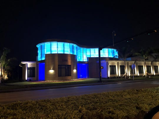 The new Engle Dentistry headquarters on U.S. 41 lights up the road at night.