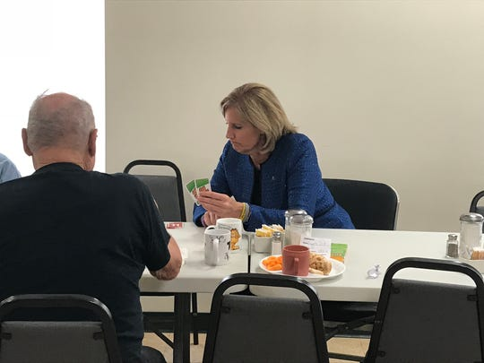 Republican Rep. Claudia Tenney plays cards at the Northern Broome Senior Community Center in Whitney Point.