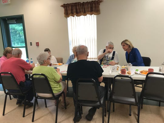 Rep. Claudia Tenney learns how to play the card game Skip-Bo at the Northern Broome Senior Community Center.