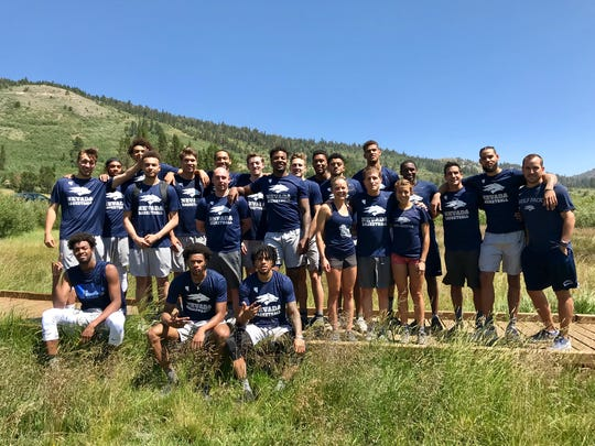 The Nevada basketball team hangs out with Wolf Pack cross country runners Hiley Dobbs and Stefanie Ortega after this run at Tahoe Meadows on Friday.