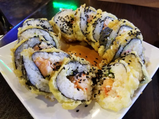 The Franklin Roll ($8) is a battered and fried roll withsalmon, crab, cream cheese, tampico paste and avocado.