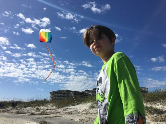 Iden Elliott flies a kite on Jekyll Island in 2015.