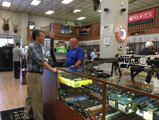 Ben Cline talks to an employee at Nuckols Gun Works