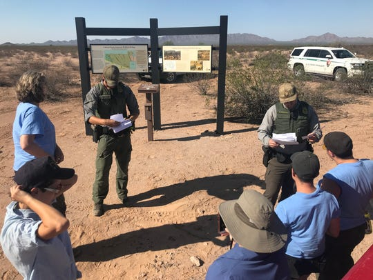U.S. Park Rangers check the individual access permits