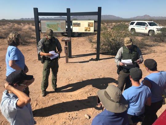 U.S. Park Rangers check the individual access permits
