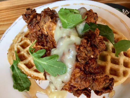 The chicken atop waffles at Brix Project brunch was