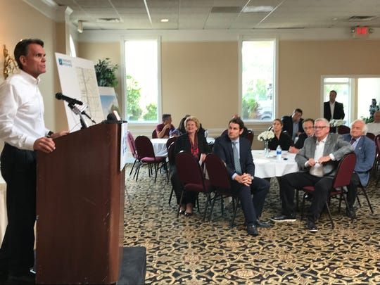 Macomb County Executive Mark Hackel speaks Aug. 6, 2018 in Warren as officials from Warren, Sterling Heights and Michigan's Congressional delegation listen to an update about nearly $98 million in federal funds that is coming to rebuild Mound Road.
