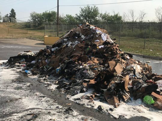 An extinguished fire at the Larimer County Landfill recycling center.