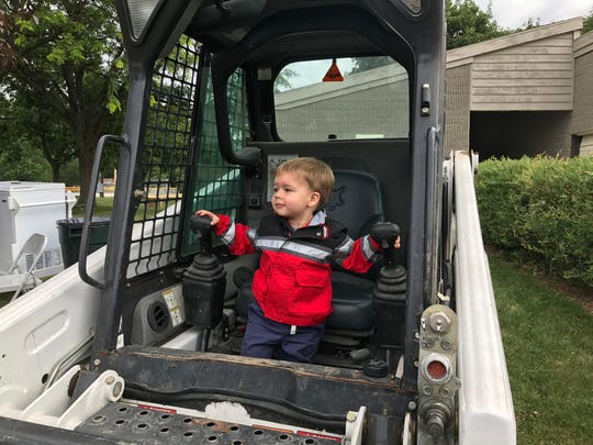 A child sits in a truck at Delta Township's Touch A