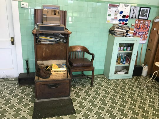 An antique shoeshine stand waits for a customer who