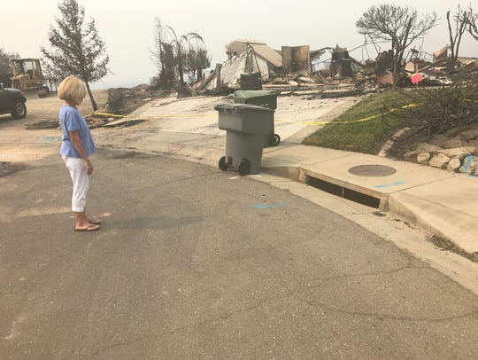 Toni Miller stands near the storm drain where the Millers'