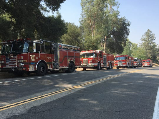 Firetrucks line up to battle the Holy Fire, the wildfire that has scorched nearly 10,000 acres in the Cleveland National Forest since Monday, August 6, 2018.