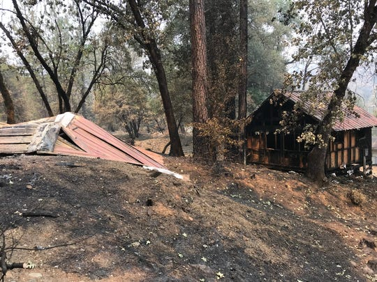 As seen in August 2018, Several of the cabins at the Whiskeytown N.E.E.D. Camp were burned in the Carr Fire. Many other buildings survived the blaze, though.