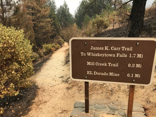 The trail to Whiskeytown Falls is surrounded by burn, but officials with the National Park Service said they have yet to assess the condition of trails around the lake.