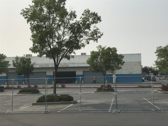 A fence has gone up around the old Sears store in the