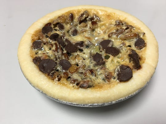 The I-40 pie at Buttermilk Sky Pie Shop features pecans, chocolate chips and coconut.