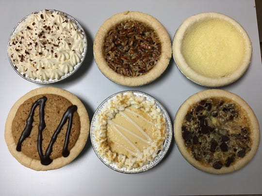 Six flavors found recently at Buttermilk Sky Pie Shop include, clockwise from top left, chocolate cream, pecan, Southern custard, I-40, key lime and chewy chocolate chip.