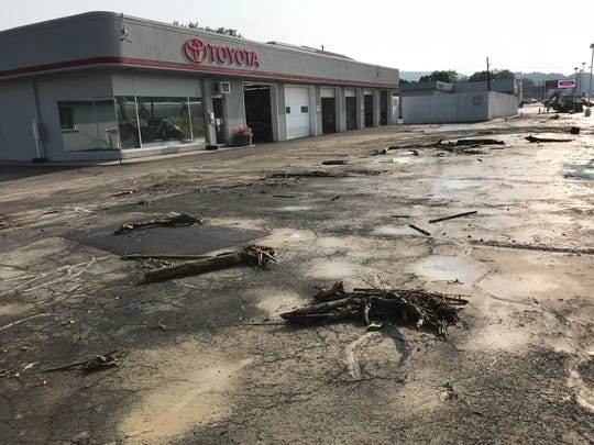 Debris littered the parking lot of Jack Sherman Toyota's