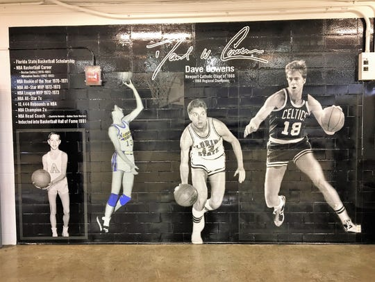 A mural in the NewCath gymnasium honors Dave Cowens,