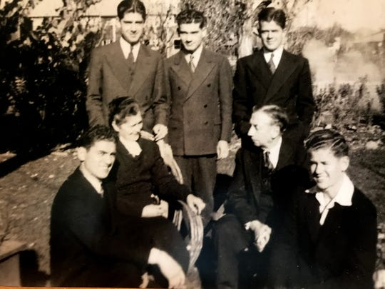 The Carr family gathered for a Thanksgiving, back row, from left, Francis, Laurence and James Carr. Middle row, Mary Agnes Kennedy Car, left and Francis Carr. Front row, left, Paul and Kenneth Carr.