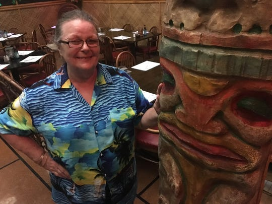 Omni Hut owner Polly Walls-Balakhani stands in front