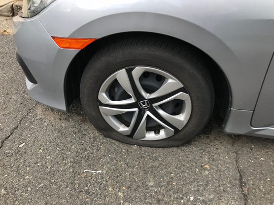 Tires were slashed on approximately 80 vehicles in
