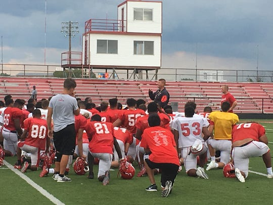 Fairfield coach Jason Krause addresses the Indians after practice Aug. 29.