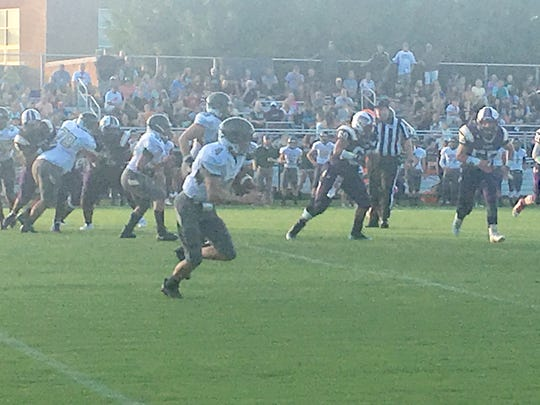 Wilson Memorial's Ty Hevener races up the field on a 70-yard swing pass. The TD was called back by a penalty.