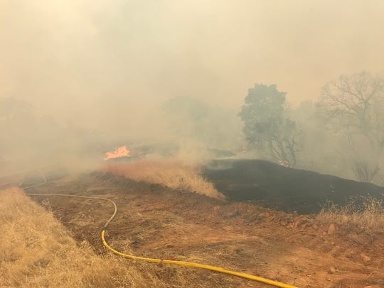 A fire off Quartz Hill Road Sunday afternoon threatened