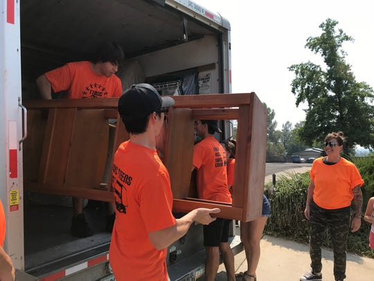 Volunteers with Trucks and Teens  Assist Shasta County unload a moving truck on Sept. 1, 2018 to help Redding area residents affected by the Carr Fire.