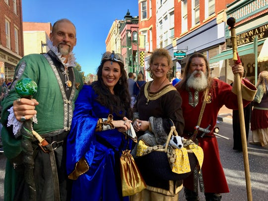 The Founders of Hogwarts Salazar Slytherin and Rowena Ravenclaw (Staunton's Dan and Dianna Pittman) with Helga Hufflepuff and Godric Gryffindor (Churchville's Chris and Mia Pugh) greet visitors on Beverley Street at last year's Queen City Mischief & Magic.