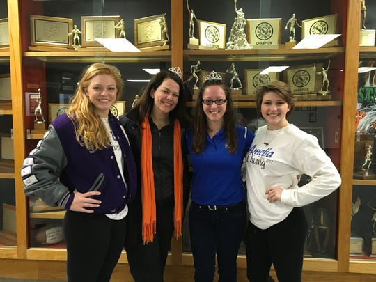 Bethany Berger, left, poses with then-Loveland AD Julie Renner, coach Lisa Werwinski and Morgan Southall.  When Berger was at Glen Este and Southall at Amelia, Renner allowed Coach Werwinski to tutor them along with Loveland's divers.  Berger is now at Eastern Michigan and Werwinski coaches Southall at West Clermont. Southall just committed to dive at Kentucky.