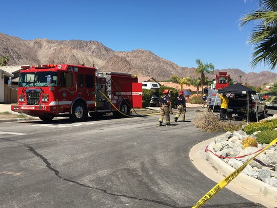 Cal Fire firefighters are shown outside a La Quinta