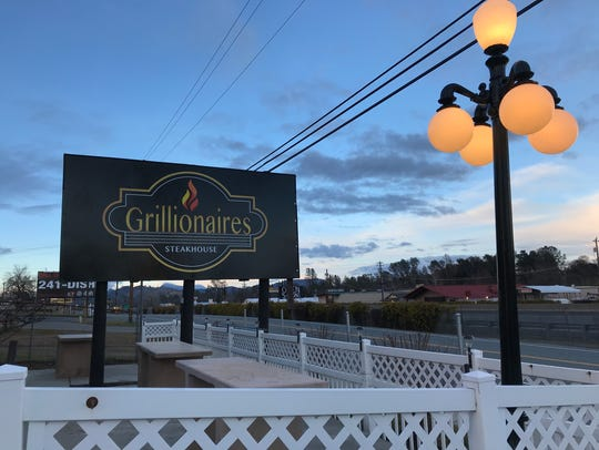 The sign for Grillionaires on Cascade Boulevard in