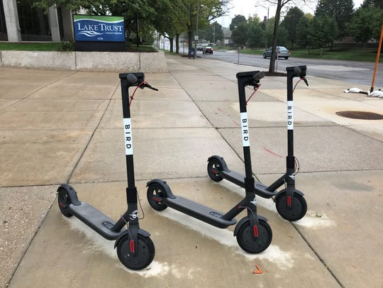 Bird scooters are parking in downtown Lansing at the