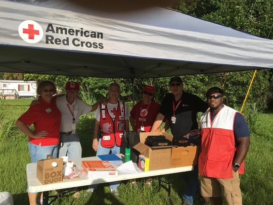 Red Cross and United Way volunteers gather together
