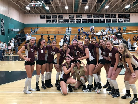 The Riverdale High School volleyball team poses with the Class 8A District 12 championship after defeating Gulf Coast High School in straight sets, 25-19, 25-20 and 25-23.