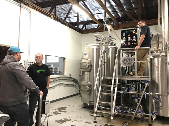 A Wednesday in November 2018 was brew day at Woody's in downtown Redding. Fall River co-owner John Hutchings, left, Woody's co-owner Scott Wlodarczyk, center, and Woody's co-owner Andrew Wlodarczyk help start the process of making Resilience IPA. Wildcard also has joined the two other breweries.