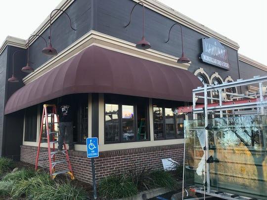 Workers replace windows that were broken Sunday night