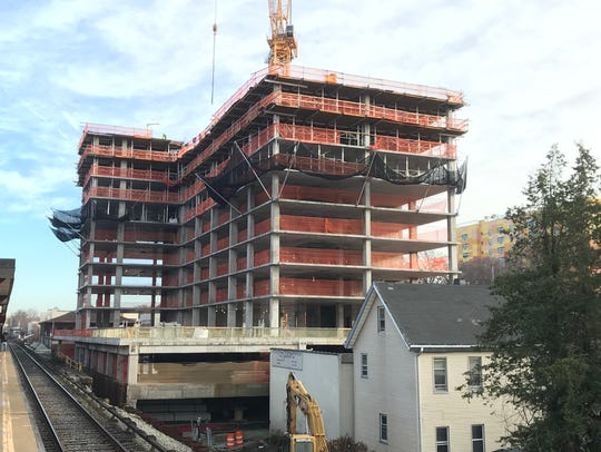 A residential tower under construction next to the